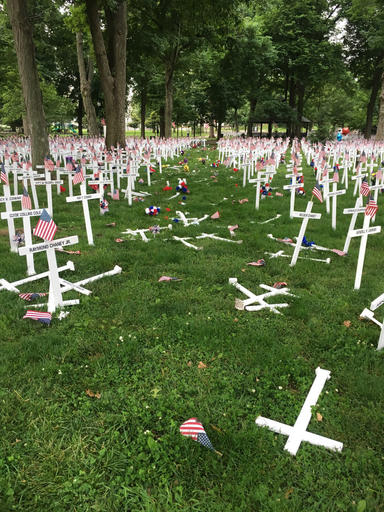 This photo provided by the Henderson Police Department shows a Memorial Day display of crosses after a vehicle drove through them in Henderson, Ky.'s Central Park on Saturday, May 28, 2016. The display honors the names of more than 5,000 from the city and county of Henderson who served in conflicts dating back to the Revolutionary War. (Joe Whitledge/Henderson Police Department via AP)