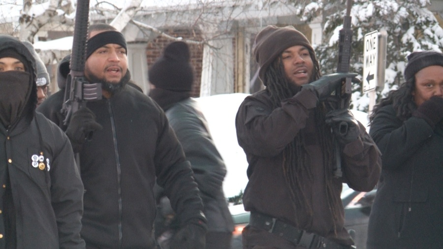 Black Panthers of Milwaukee carrying assault rifles.