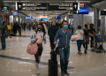 Travelers wearing masks try to reduce the risk of contracting coronavirus.  (Wikipedia)