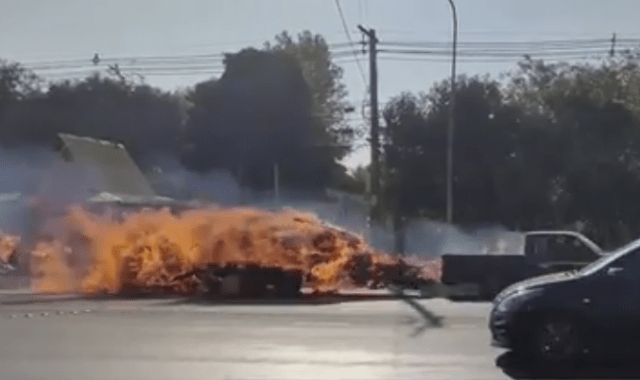 Truck towing flaming trailer