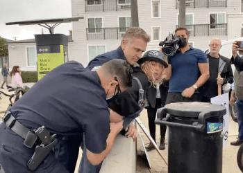 Officers wrestle knife
