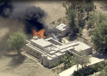 A home burns in the 2600 block of W Bent Spur Drive on Tuesday, It is believed this incident is related to a shooting at nearby L.A. County Fire Station 81.